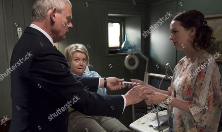 Stock Photo of (SR8: Ep4) - Martin Clunes as Doc Martin, Rebecca Lacey as Tara Newcross and Jessica Ransom as Morwenna Newcross