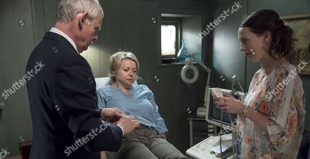 Stock Picture of (SR8: Ep4) - Martin Clunes as Doc Martin, Rebecca Lacey as Tara Newcross and Jessica Ransom as Morwenna Newcross