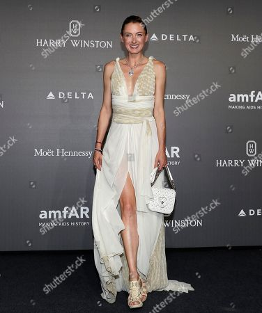 Princess Lilly zu Sayn Wittgenstein-Berleburg poses for photographers as she arrives for the amfAR charity dinner during the fashion week in Milan, Italy