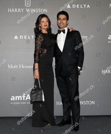 Stock Photo of Veronica Berti, left, and Amos Bocelli pose for photographers as they arrive for the amfAR charity dinner during the fashion week in Milan, Italy