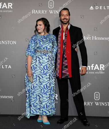 Teresa Maccapani Missoni and Francesco Missoni pose for photographers as they arrive for the amfAR charity dinner during the fashion week in Milan, Italy