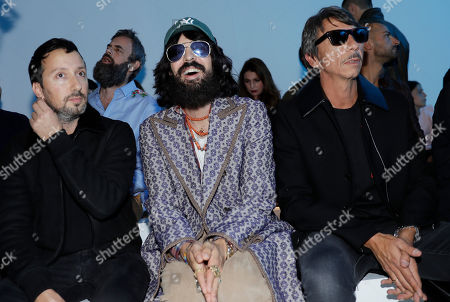 From left, Anthony Vaccarello, Alessandro Michele and Paolo Piccioli attend the Versace women's Spring/Summer 2018 fashion collection, presented in Milan, Italy