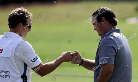 Patrick Reed, Kessler Karain. Patrick Reed, right, fist-bumps his caddie, Kessler Karain, after finishing the second round of the Tour Championship golf tournament on the 18th hole at East Lake Golf Club in Atlanta