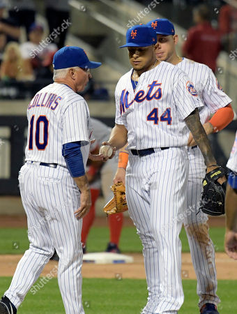 AJ Ramos, Terry Collins. New York Mets manager Terry Collins (10) takes the ball from pitcher AJ Ramos during the ninth inning of a baseball game against the Washington Nationals, in New York
