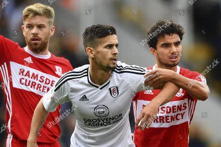 Rui Fonte of Fulham grapples with Fabio Da Silva of Middlesbrough