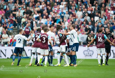 Players clash after an incident between Winston Reid and Fernando Llorente. Both players get a booking, along with Andy Carroll and Eric Dier. English Premier League West Ham v Tottenham Hotspur, London Stadium, London, United Kingdom on 23rd September 2017