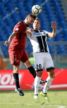 Stock Image of Roma's Daniele De Rossi, left, and Udinese's Maxi Lopez jump for the ball during an Italian Serie A soccer match between Roma and Udinese, at the Olympic stadium in Rome