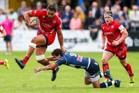 Stock Image of Chris Vui of Bristol Rugby is challenged by Lee Dickson of Bedford Blues