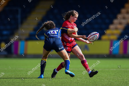 Charlotte Holland of Bristol Ladies is tackled by Brooke Clarke of Worcester Valkyries