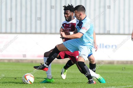 Stock Picture of Josh Morgan- Williams of Paultown Rovers battles for the ball with Ben Whitehead of Cirencester Town during the Evostik Southern League Divison 1 West match between Paulton Rovers and Cirencester Town at The Athletic Ground, Paulton, Bristol on September 23.