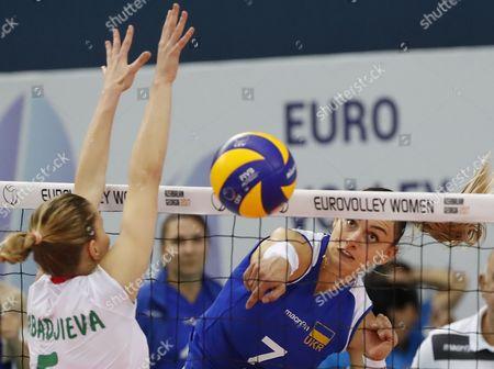 Stock Image of Dobriana Rabadjieva (L) of Bulgaria in action against Inna Molodtsova (R) of Ukraine during the 2017 CEV Volleyball Women European Championship match between Bulgaria and Ukraine in Baku, Azerbaijan, 23 September 2017.