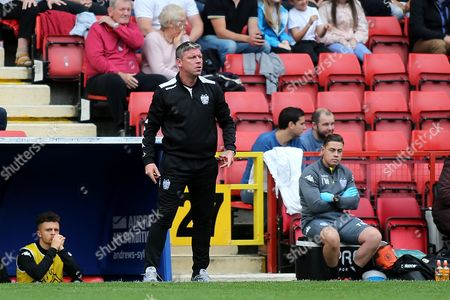 Bury Manager, Lee Clark, was nowhere to be seen in the dugout and Assistant Manager, Alan Thompson, seemed to be charge of proceedings during Charlton Athletic vs Bury, Sky Bet EFL League 1 Football at The Valley on 23rd September 2017