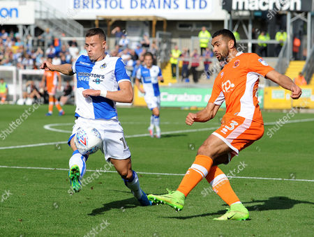 Billy Bodin of Bristol Rovers challenges Andy Taylor of Blackpool