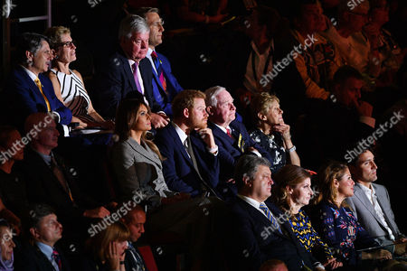 Prince Harry (C) watches the opening ceremony of the Invictus Games while sitting with Melania Trump (L), and Governor General of Canada David Johnston and wife Sharon Johnston.