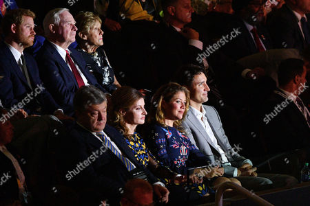 Justin Trudeau and Sophie Grégoire watch the opening ceremony of the Invictus Games along with Prince Harry and Governor General of Canada David Johnston and wife Sharon Johnston.
