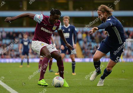 Keinan Davis of Aston Villa and Matthew Mills of Nottingham Forest during the Championship match at Villa Park, Birmingham