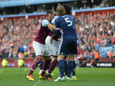 John Terry of Aston Villa and Matthew Mills of Nottingham Forest pull each others shirts during the Championship match at Villa Park, Birmingham