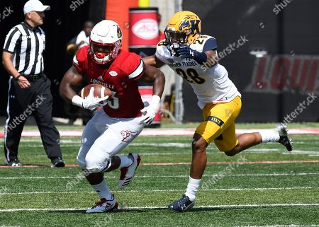 Colin Wilson, Manny Lawrence-Burke. Louisville's Colin Wilson (33) runs from the pursuit of Kent State's Manny Lawrence-Burke (28) during the second half of an NCAA college football game, in Louisville, Ky. Louisville won 42-3
