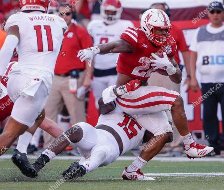 Trevor Morris, Devine Ozigbo. Nebraska running back Devine Ozigbo (22) is tackled by Rutgers linebacker Trevor Morris (15) during the second half of an NCAA college football game in Lincoln, Neb., . Nebraska won 27-17