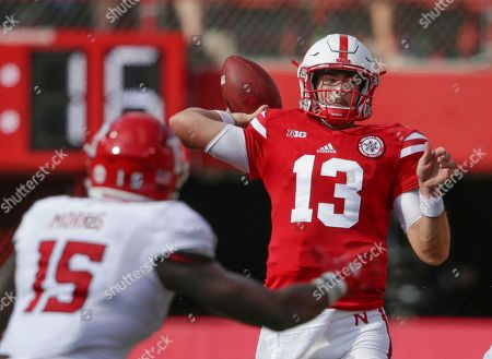 Tanner Lee, Trevor Morris. Nebraska quarterback Tanner Lee (13) throws as Rutgers linebacker Trevor Morris (15) closes in, during the first half of an NCAA college football game in Lincoln, Neb