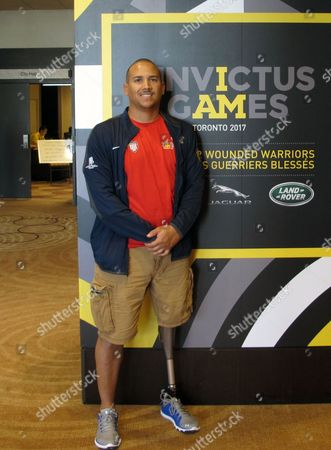 U.S. Master Sergeant Brian Williams poses for a photo at the Invictus Games, in Toronto. Williams, who's left leg was amputated at the knee because of an IED explosion in Afghanistan in 2012, said Invictus founder Prince Harry is living up to the legacy of his late mother Diana with his charity work