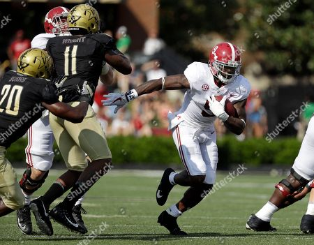Bo Scarbrough, Charles Wright, Oren Burks. Alabama running back Bo Scarbrough (9) carries the ball past Vanderbilt defenders Charles Wright (11) and Oren Burks (20) in the first half of an NCAA college football game, in Nashville, Tenn