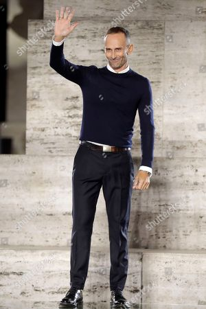 Stock Image of Ferragamo fashion designer Fulvio Rigoni waves at the end of the presentation of the women's Spring/Summer 2018/19 fashion collection, in Milan, Italy