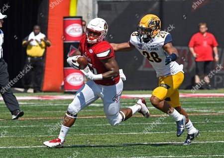 Colin Wilson, Manny Lawrence-Burke. Louisville running back Colin Wilson (33) attempts to outrun the pursuit of Kent State safety Manny Lawrence-Burke (28) during the second half of an NCAA college football game, in Louisville, Ky. Louisville won 42-3