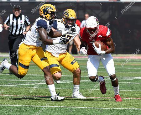 Seth Dawkins, Jim Jones, Nick Faulkner. Louisville wide receiver Seth Dawkins (5) is pursued by Kent State linebacker Jim Jones (22) and defensive end Nick Faulkner (17) during the first half of an NCAA college football game, in Louisville, Ky