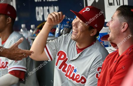 Philadelphia Phillies left fielder Hyun Soo Kim cuts up in the dug out before a baseball game against the Atlanta Braves, in Atlanta