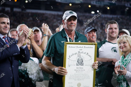 "Former Michigan State star Kirk Gibson is honored during the first quarter of an NCAA college football game against Notre Dame, Mich. Gibson had his name and No. 23 inducted into the Spartan Stadium ""Ring of Fame"