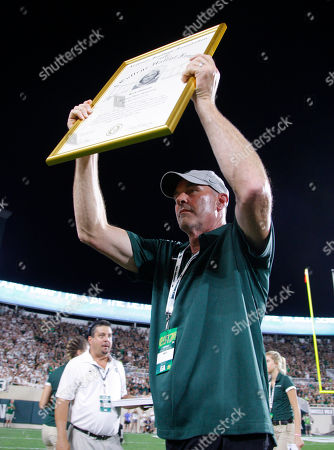 "Former Michigan State star Kirk Gibson is honored during the team's NCAA college football game against Notre Dame, Mich. Gibson had his name and No. 23 inducted into the Spartan Stadium ""Ring of Fame"