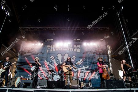 Bob Crawford, Scott Avett, Seth Avett, Joe Kwon, Tania Elizabeth. Bob Crawford, from left, Scott Avett, Seth Avett and Joe Kwon of The Avett Brothers, and Tania Elizabeth, perform at the Pilgrimage Music and Cultural Festival, in Franklin, Tenn
