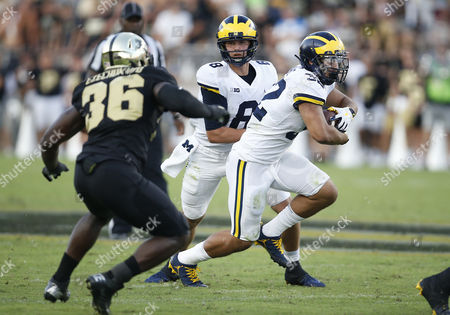 Michigan running back Ty Isaac (32) runs with the ball during NCAA football game action between the Michigan Wolverines and the Purdue Boilermakers at Ross-Ade Stadium in West Lafayette, Indiana. Michigan defeated Purdue 28-10