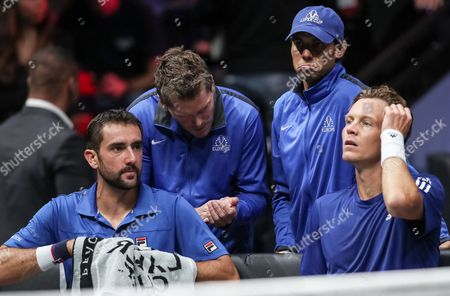 Stock Photo of Czech Republic's Tomas Berdych (R) and Croatian Marin Cilic (L) of the Team Europe speak with their vice captain  Thomas Enqvist (2L) and their team mate Spanish Rafael Nadal (2R) during match against US Jack Sock and US John Isner of the Team World during the Laver Cup tennis tournament in Prague, Czech Republic, 24 September 2017.