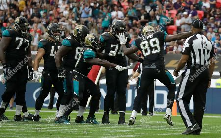 Leonard Fournette, Marcedes Lewis. Jacksonville Jaguars running back Leonard Fournette, center, indulges in a celebration routine with Marcedes Lewis (89) after scoring a touchdown against the Baltimore Ravens during the second half of an NFL football game at Wembley Stadium in London
