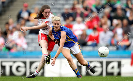 Tipperary vs Tyrone. Tyrone's Grain Rafferty scores the first goal of the game despite the efforts from Jennifer Grant of Tipperary