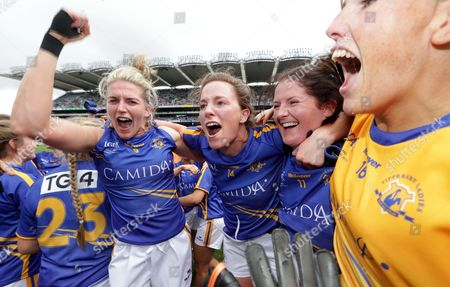 Stock Image of Tipperary vs Tyrone. Tipperary's Jennifer Grant, Gillian O'Brien, Mairead Morrissey and Patricia Hickey celebrate winning the Intermediate Final