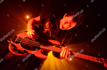 Bassist Jaime Preciado of the band Pierce The Veil performs at the Skyway Theatre in Minneapolis, Minnesota