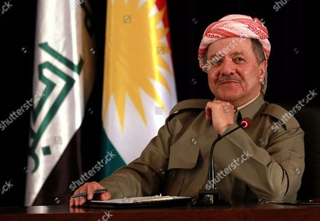 """President of Iraq's autonomous Kurdish region Massoud Barzani speaks to reporters during a press conference in Salah al-Din resort, Irbil north of Baghdad, Iraq, . Barzani said Sunday, that the controversial vote on independence will go ahead as planned and that while the vote will be the first step in a long process to negotiate independence, the region's """"partnership"""" with the Iraqi central government in Baghdad is over"""