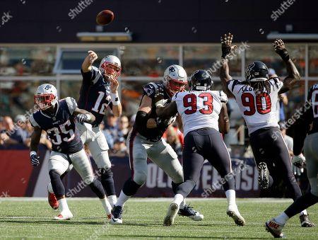 Tom Brady, Joel Heath, Jadeveon Clowney. New England Patriots quarterback Tom Brady (12) passes under pressure from Houston Texans defensive end Joel Heath (93) and linebacker Jadeveon Clowney (90) during the second half of an NFL football game, in Foxborough, Mass
