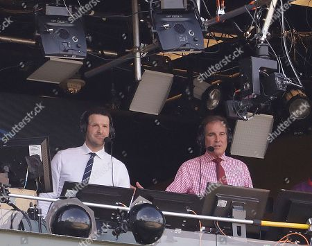 Tony Romo and Jim Nantz are seen in the broadcast boothnbefore an NFL football game between the Green Bay Packers and the Cincinnati Bengals, in Green Bay, Wis