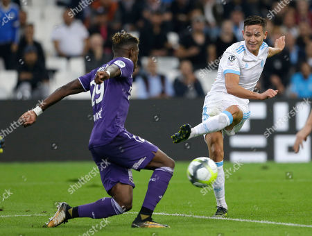 Florian Thauvin, Francois Moubandje. Marseille's Florian Thauvin, right, challenges for the ball with Toulouse's Francois Moubandje, during the League One soccer match between Marseille and Toulouse, at the Velodrome stadium, in Marseille, southern France