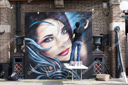 David Barrera, street artist works on a mural