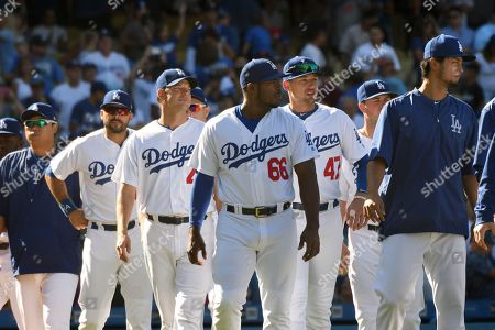 Hyun-Jin Ryu, Andre Ethier, Rich Hill, Yasiel Puig, Trayce Thompson, Yu Darvish. Los Angeles Dodgers Hyun-Jin Ryu, Andre Ethier, Rich Hill, Yasiel Puig, Trayce Thompson and Yu Darvish, from left, come out of the dugout to congratulate teammates after defeating the San Francisco Giants 3-1 after a baseball game, in Los Angeles