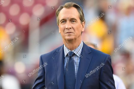 Stock Photo of Commentator Chris Collinsworth walks the sideline before the Sunday night matchup between the Oakland Raiders and the Washington Redskins at FedEx Field in Landover, MD