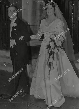 Editorial photo of Wedding Of Miss Marian Manningham-buller Eldest Daughter Of The Attorney-general Sir Reginald Manningham-buller To Edmund Brudenell At St. Margaret's Westminster. Box 732 321021744 A.jpg.