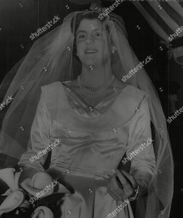 Stock Photo of Wedding Of Miss Marian Manningham-buller Daughter Of The Attorney-general Sir Reginald Manningham-buller To Edmund Brudenell At St. Margaret's Westminster. Box 732 321021743 A.jpg.