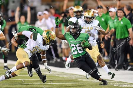 North Texas Mean Green running back Evan Johnson (26) runs a kick return for 40 yards as North Texas Mean Green tight end Kelvin Smith (87) blocks to setup a game wining field goal during an NCAA Football game between the University Alabama Birmingham Blazers and the North Texas Mean-Green Eagles at Apogee Stadium in Denton, Texas