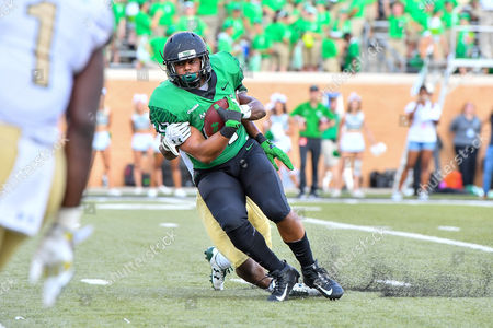North Texas Mean Green tight end Kelvin Smith (87) catches a pass for a first down during an NCAA Football game between the Univerisity Alabama Birmingham Blazers and the North Texas Mean-Green Eagles at Apogee Stadium in Denton, Texas